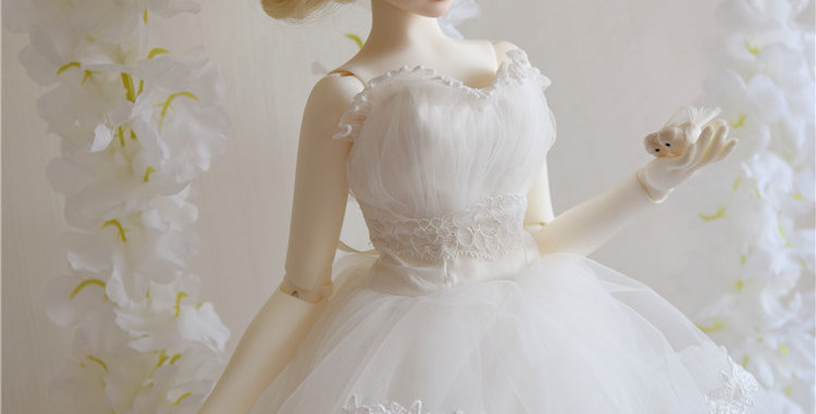 Short in front Wedding Dress by D.Y.M
