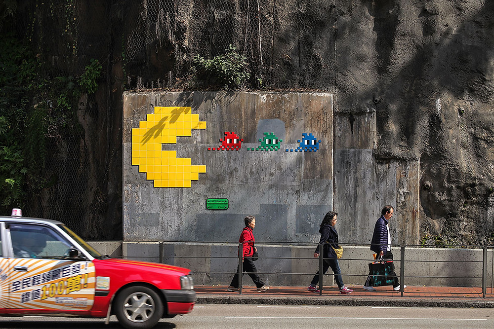 SaaS Is Eating The Security World. Photo: Invader art in Hong Kong https://www.space-invaders.com/world/hong-kong/