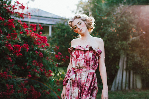 professional fashion photographer brisbane: photoshoot of female model posing in pink floral dress