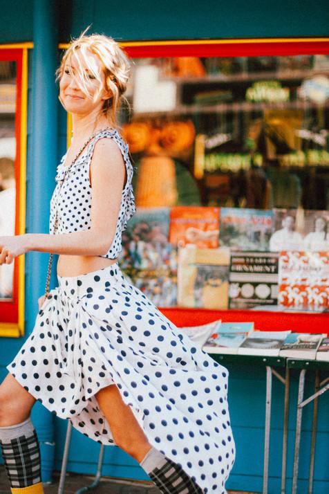 professional fashion photographer brisbane: photoshoot of female modeling polka dot clothing