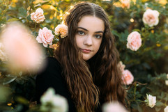 professional model photography brisbane: portfolio photoshoot of female between roses