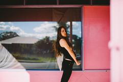 professional model photography brisbane: portfolio photoshoot of female posing infront of pink store window