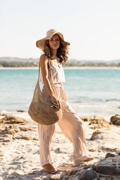 professional fashion photographer gold coast: photoshoot of female modeling summer outfit at beach