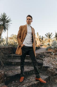 professional model photography brisbane: portfolio photoshoot of male wearing suit posing on steps