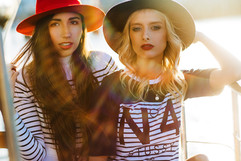 professional fashion photographer gold coast: lifestyle photoshoot of two female models in hats and striped clothing