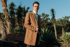 professional model photography brisbane: photoshoot of male modeling a trench coat