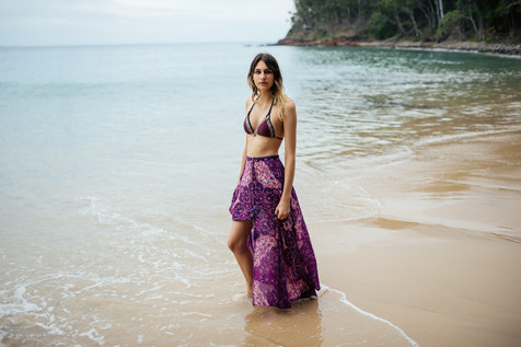professional model photography sunshine coast: portfolio photoshoot of female wearing purple sarong and bikini on beach