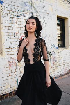 professional fashion photographer brisbane: photoshoot of female modeling black lace dress