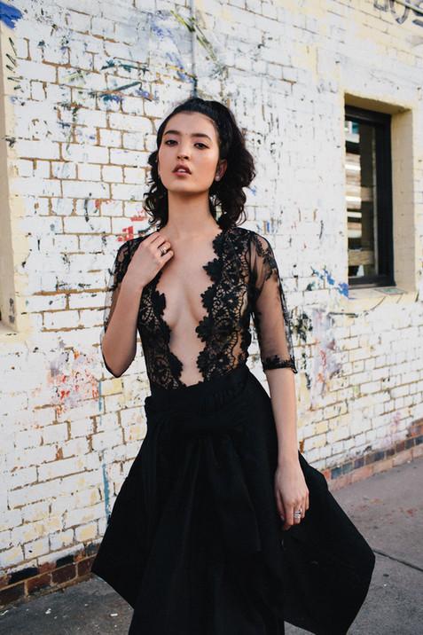 professional fashion photographer brisbane: photoshoot of female modeling a black lace dress