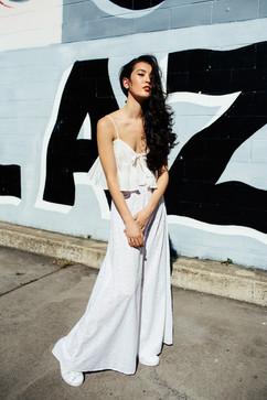 professional fashion photographer brisbane: photoshoot of female posing in white outfit