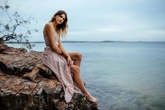 professional model photography gold coast: portfolio photoshoot of female modeling on beach cliff