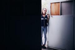 professional fashion photographer brisbane: grunge lifestyle photoshoot of female opening door