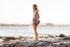 professional fashion photographer byron bay: lifestyle photoshoot of female wearing summer outfit at beach