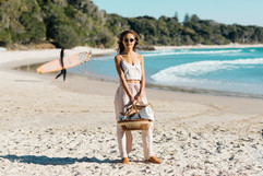 professional fashion photographer byron bay: photoshoot of female model posing at the beach