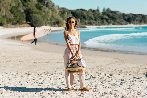 professional fashion photographer gold coast: photoshoot of female posing at the beach with basket