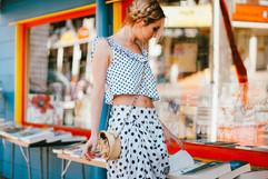 professional fashion photographer brisbane: photoshoot of female model wearing polka dot clothing