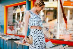 professional fashion photographer brisbane: photoshoot of female modeling polka dot outfit