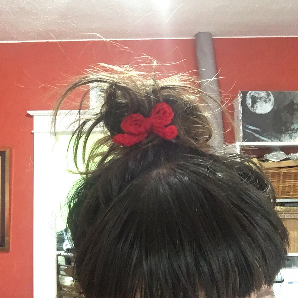 My messy hair with a little crochet bow barrette.