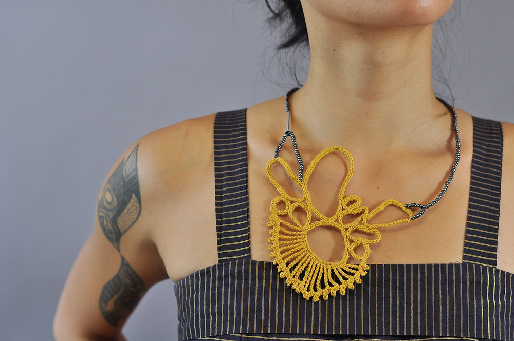 Asymmetric Lace Statement Necklace by Freda Mohr.