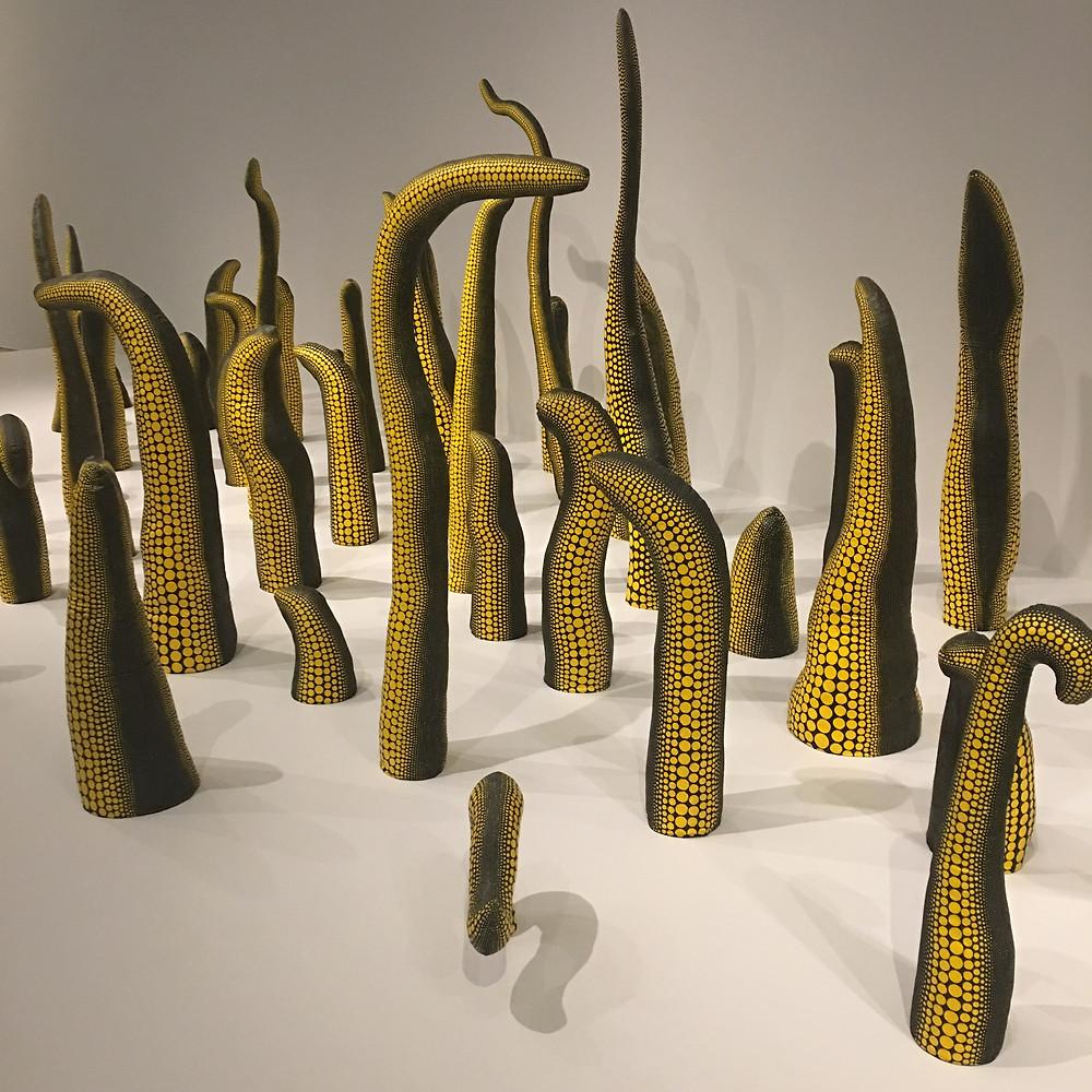 Spiky yellow and black Kusama sculptures