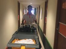 Room attendant at corridor