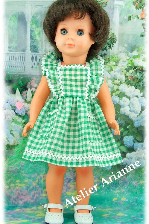 Tenue pour poupée Modes et Travaux pour Françoise , le tablier d'avril 1953