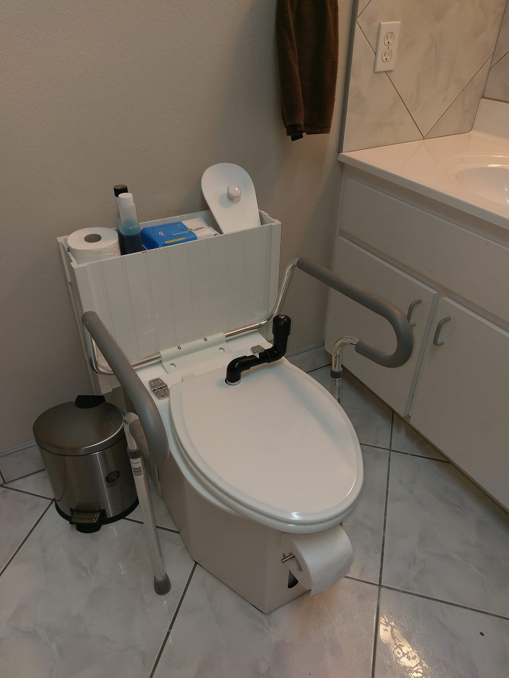 Docking cabinet for ADA dimensional standard ready c-head composting toilet
