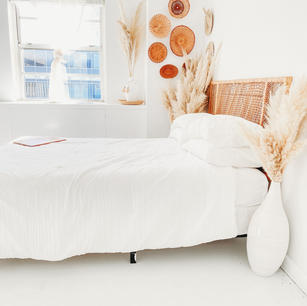 Queen Sized Bed with White Bedding