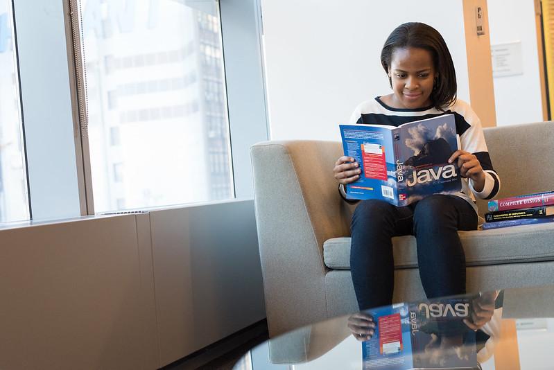 Software developer reading a Java book