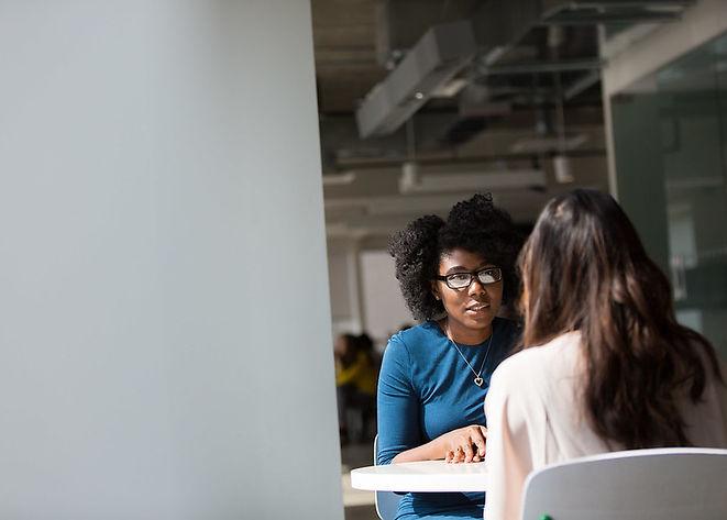 women-engaged-in-conversation.jpg