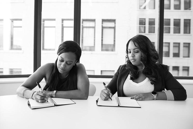 Women writing down notes