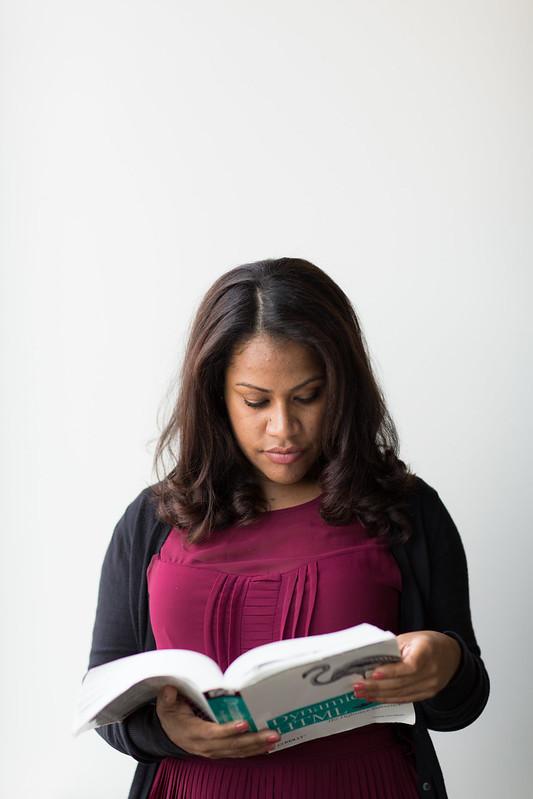 Woman reading a tech book