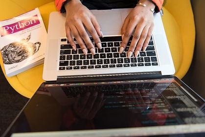 Creating a developer blog: Developer typing on a laptop