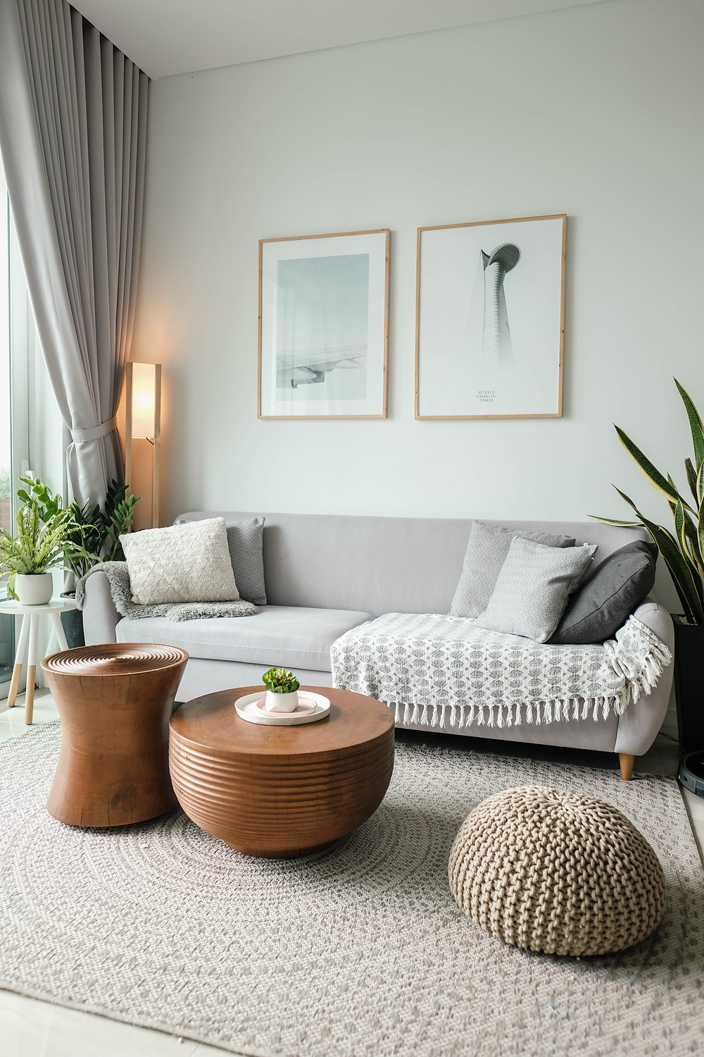 Comfy living room with sofa and bright interior