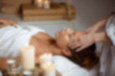 young-woman-having-face-massage-relaxing