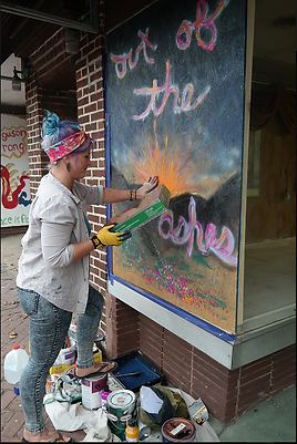 Artist Painting Murals.png