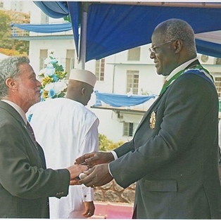 Joseph Opala receiving the Order of the