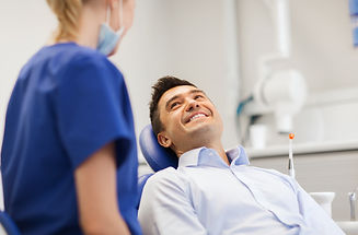 female dentist with happy male patient a