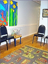 This is a picture of the colorful waiting room at The Kids' Communication Center, a pediatric private speech therapy practice that provides speech-language therapy to kids or children in Tenleytown, Washington DC