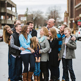 Large family hanging out downtown