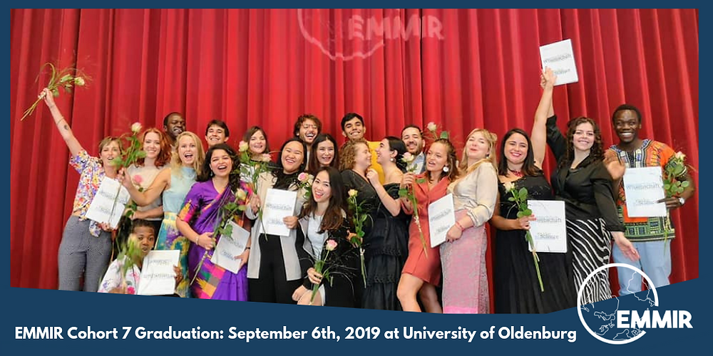 Cohort 7 students celebrate with their diplomas, holding roses