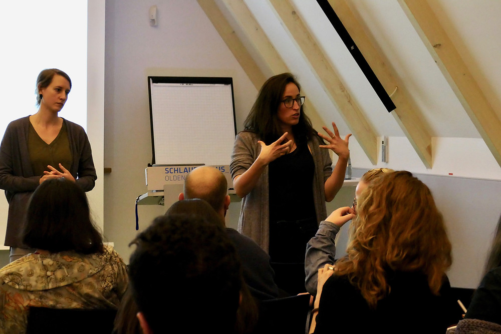 Kelly Miller and Sophia Burton from MigrationMatters speaking to an audience of EMMIR students and civil society in Oldenburg, Germany.