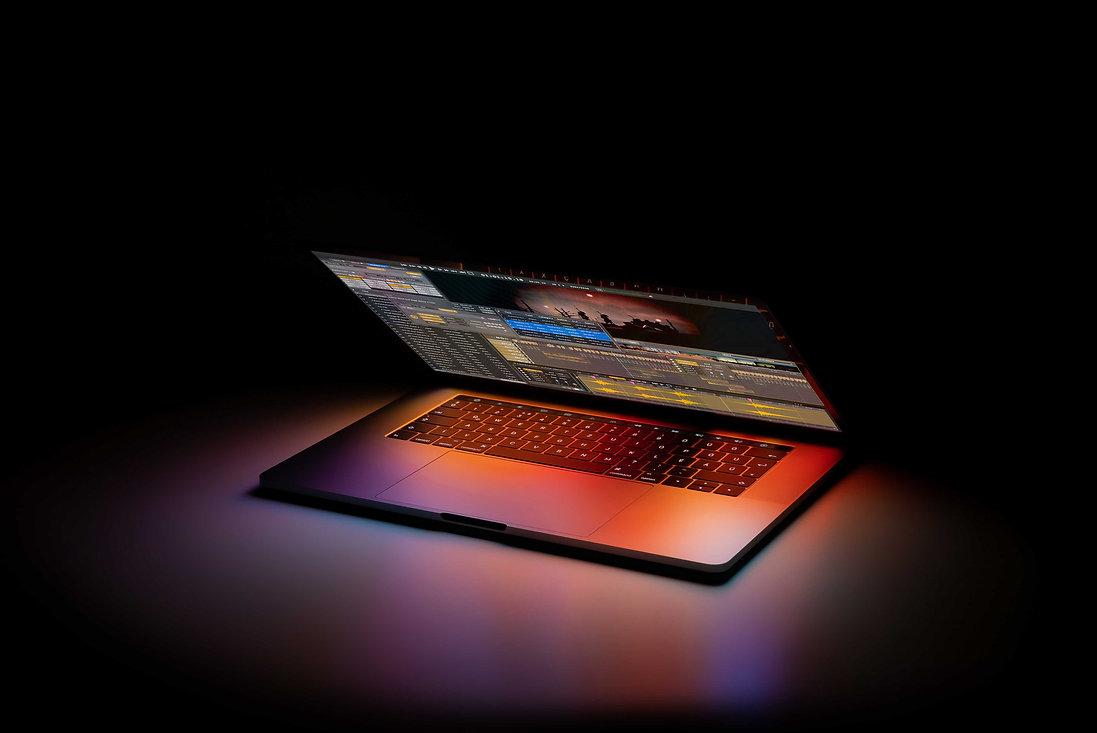 Glowing-Computer-Open-On-Black.jpeg