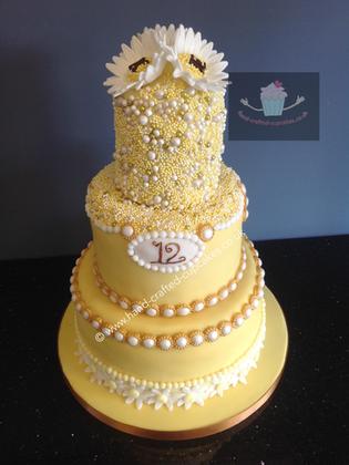 AC-140-Yellow-Anniversary-Cake