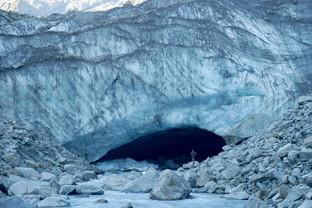 Hiker in front of Dart Glacier, New Zealand