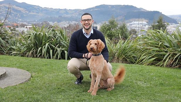 Josh, a local insurance adviser explains how easy insurance is. A Dunedin Insurance adviser with his dog, Louie!