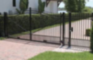 Black aluminum drive gate, with  installation by Tidewater Virginia Peninsula fence contractor