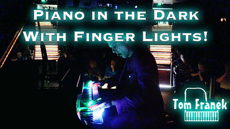 Piano in the dark with Finger Lights