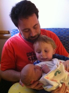 Austin Moore holds sons Tucker and Greyson.