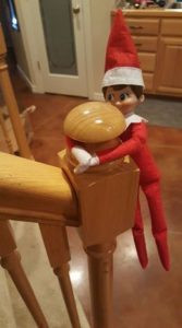 John Cena, our naughty elf, loves to slide down the stair banister!